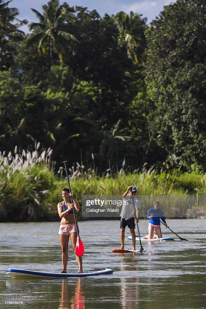 Guests from Nihiwatu Resort paddle board down Wanukaka River in Western Sumba on April 12, 2013. Sumba is a remote island in Eastern Indonesia, part of the Lesser Sunda Islands group based in the province of East Nusa Tenggara.