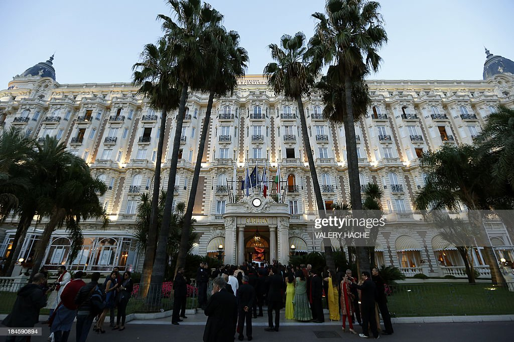 Guests gather in front of the Carlton Hotel in the southeastern French city of Cannes on October 14, 2013 during the wedding of a London-based Indian couple. The Carlton palace was entirely booked for several nights to accomodate guests for the wedding of Kunal Grover and Ria Dubash.
