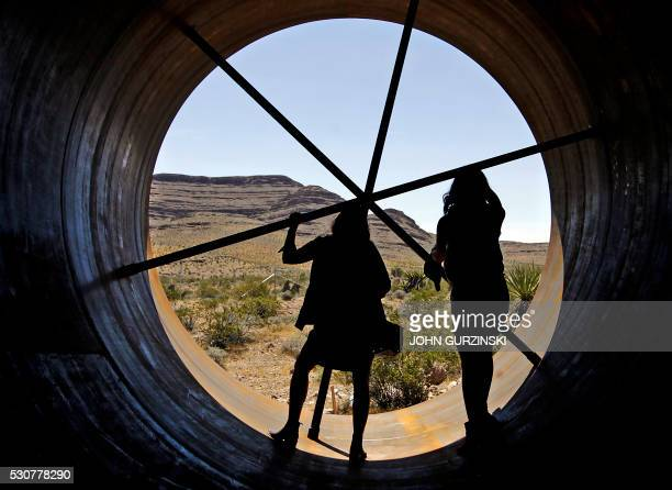 Guests get a chance to view the inside of a Hyperloop tube during the first open air propulsion test at the Hyperloop One Test and Safety site on May...