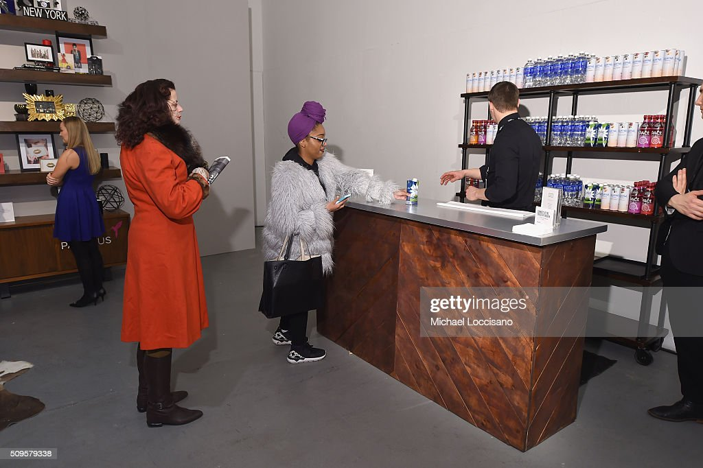 Guests get complimentary refreshments at Fall 2016 New York Fashion Week at the Skylight at Clarkson sq on February 11, 2016 in New York City.