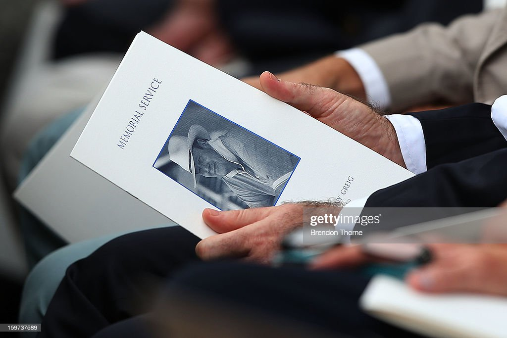 Guests hold a memorial service booklet during the Tony Greig memorial service at Sydney Cricket Ground on January 20, 2013 in Sydney, Australia.