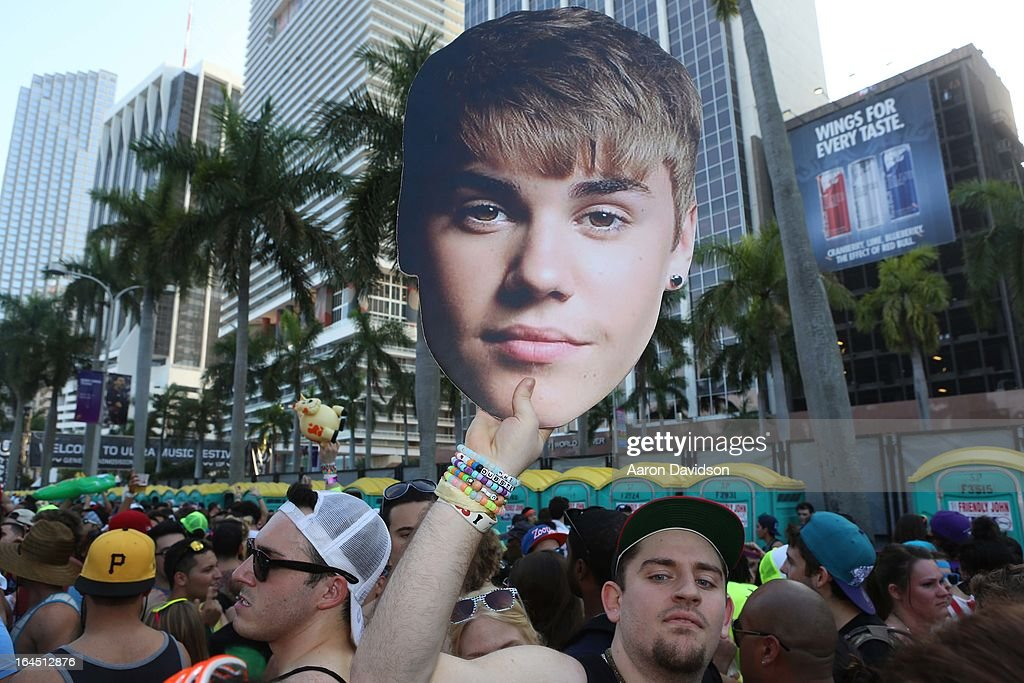 A guests holds a portrait of Justin Bieber attends Ultra Music Festival Weekend 2 at Bayfront Park Amphitheater on March 23, 2013 in Miami, Florida.
