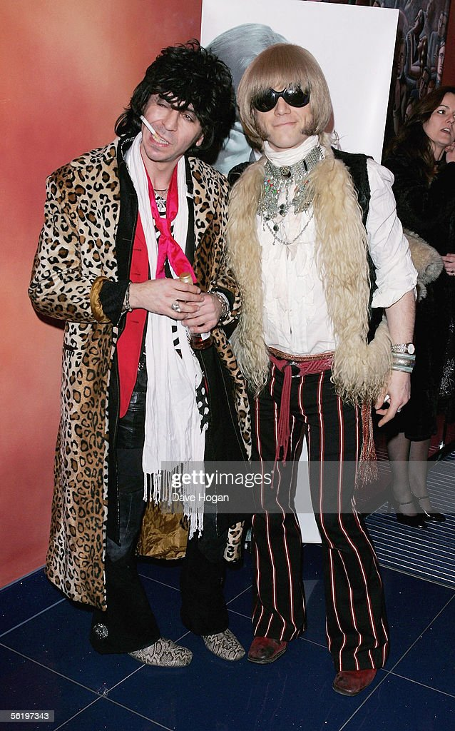 Guests in 1960's style costume arrive at the UK Premiere of 'Stoned' at the Apollo West End Cinema on November 17, 2005 in London, England. The British film chronicles the life and death of Rolling Stones co-founder Brian Jones, found drowned just weeks after being let go from the band.