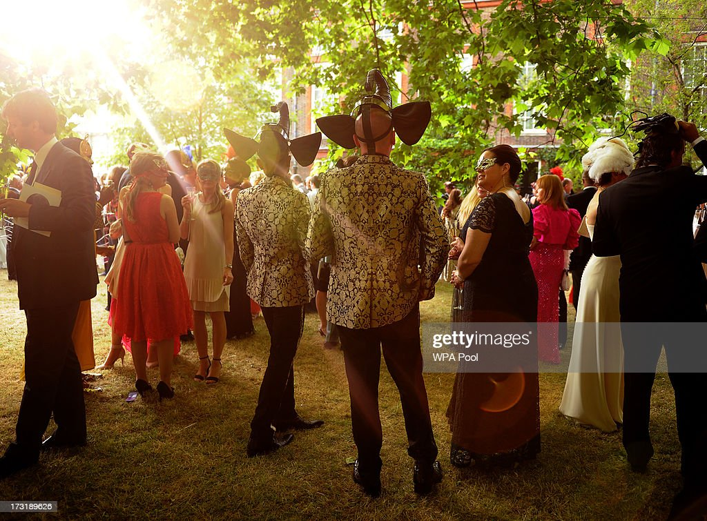 Guests in costume attend a reception hosted by <a gi-track='captionPersonalityLinkClicked' href=/galleries/search?phrase=Prince+Charles&family=editorial&specificpeople=160180 ng-click='$event.stopPropagation()'>Prince Charles</a>, Prince of Wales and Duchess of Cornwall, a charity working to save the Asian Elephant from extinction in the wild, at Clarence House on July 09, 2013 in London, England.