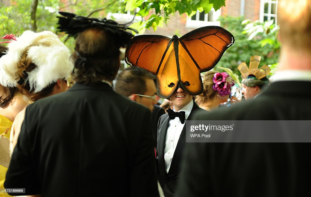 Guests in costume attend a reception hosted by Prince Charles, Prince of Wales and Duchess of Cornwall, a charity working to save the Asian Elephant from extinction in the wild, at Clarence House on July 09, 2013 in London, England.