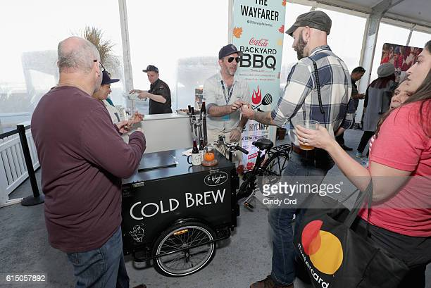 Guests in line for The Wayfarer booth at the CocaCola Backyard BBQ hosted by Bobby Flay and Michael Symon presented by Thrillist sponsored by...