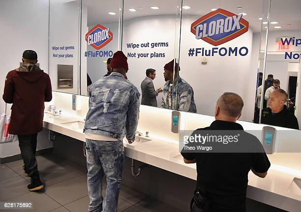 Guests in the Clorox bathroom at the Pandora Holiday Live event at Pier 36 on December 6 2016 in New York City
