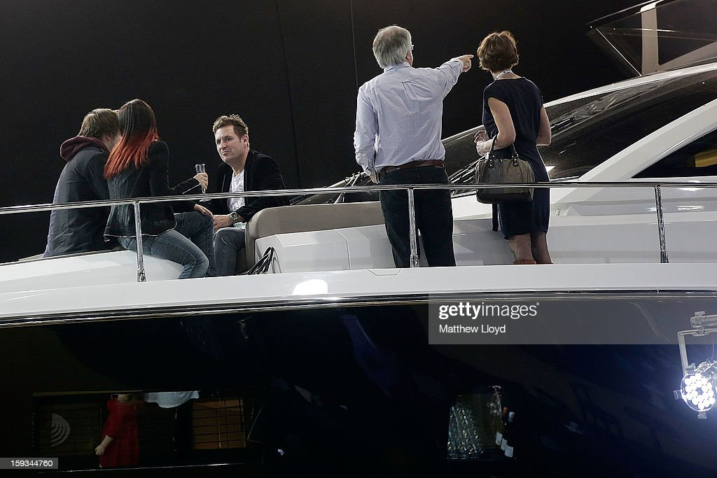 Guests inspect the boats above board and below decks at the 2013 London Boat Show, held at the eXcel centre, on January 12, 2013 in London, England. Until the 20th of January the London Boat Show will showcase, demonstrate and sell maritime equipment ranging from luxury yachts to dinghies.