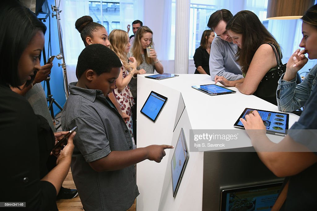 Guests interact during Ben's Beginners Cooking Contest Launch Event Back to the Future Of Cooking at Home Studios on August 23 2016 in New York City