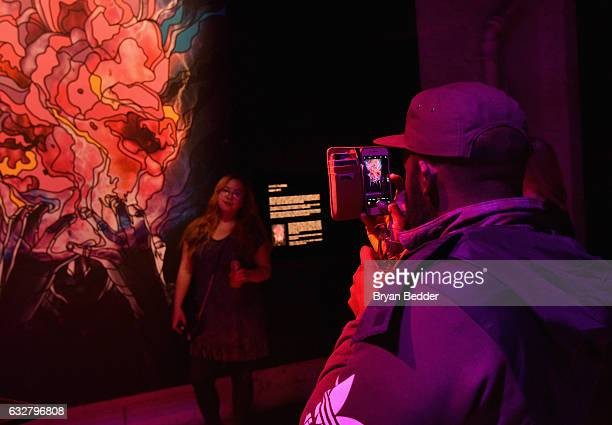 Guests interact with the art installations at the FX's Legion WhereHouse at Villian on January 26 2017 in Brooklyn New York