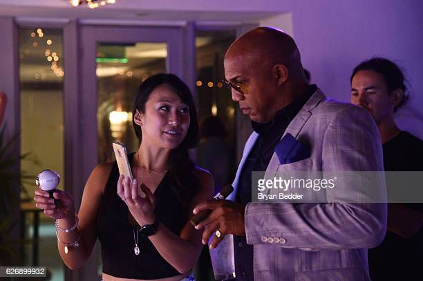 Guests interact with the Samsung 360 camera during Prabal GurungÕs Samsung Gear 360 Exhibition at Ocho at Soho Beach House during Art Basel on...