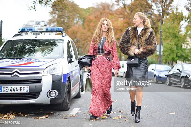 Guests leave after the Moncler Gamme Rouge show at the Grand Palais during Paris Fashion Week SS16 on October 7 2015 in Paris France