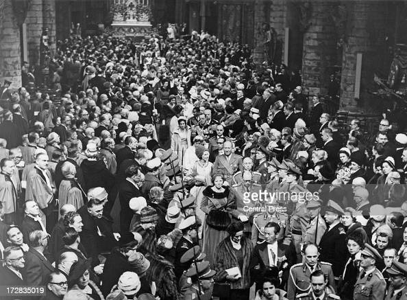 Guests leave the wedding ceremony for King Baudouin of Belgium and Queen Fabiola of Belgium at the Cathedral of St Michael and St Gudula Brussels...