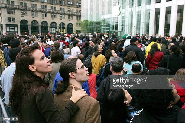 Guests line up for the opening of the Apple Store on Fifth Avenue on May 19 2006 in New York City Apple plans to keep the store open 24 hours a day 7...