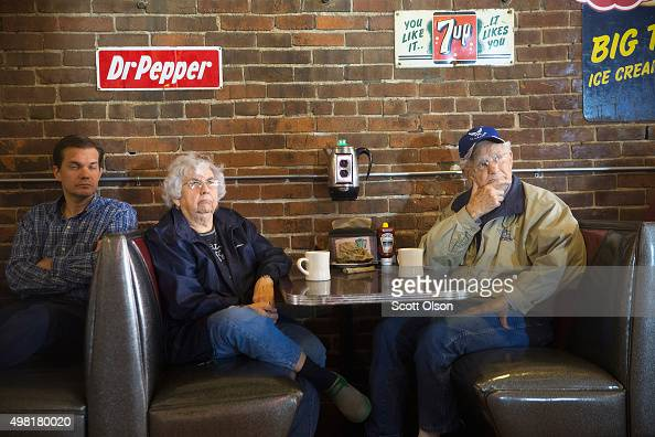 Guests listen as Republican presidential candidate Sen Marco Rubio speaks during a campaign stop at Smokey Row Coffee House on November 21 2015 in...
