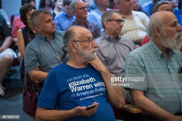 Guests listen to Rep Brian Fitzpatrick RPa during a town hall meeting in Bensalem Pa on August 22 2017