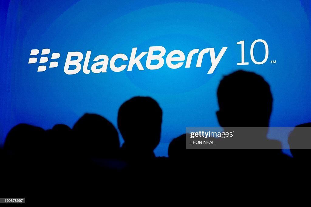 Guests listen to the presentation at one of eight simultaneous worldwide events for the launch of the BlackBerry 10 (BB10) operating system and two new handsets in London on January 30, 2013. BlackBerry launched its comeback effort with a revamped operating system and a pair of sleek new handsets, plus a company name change as the smartphone maker moves to reinvent itself. Canadian-based Research in Motion changed its name to BlackBerry as it launched the BlackBerry 10, the new platform aimed at helping the firm regain traction in a market now dominated by rivals.