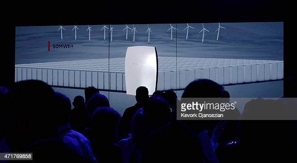 Guests look at a Powerwall system on display after Elon Musk CEO of Tesla unveiled suit of batteries for homes businesses and utilities at Tesla...