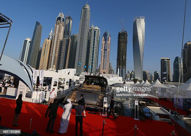 Guests look at boats displayed at Dubai's International Boat Show on March 3 2015 Over 850 international regional and local exhibitors from more than...