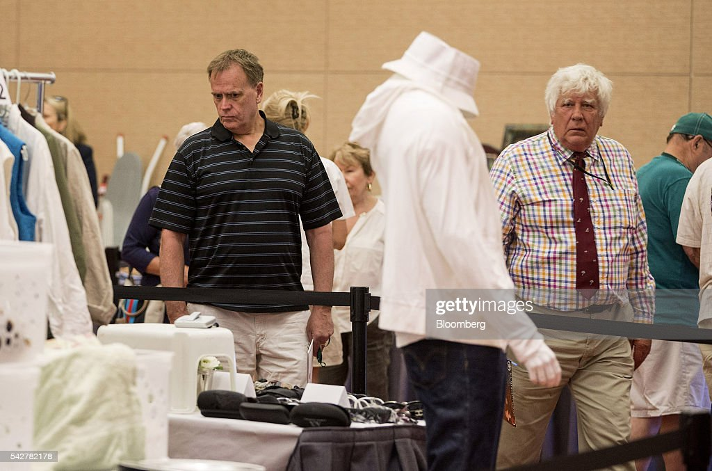 Guests look at items belonging to notorious Boston mobster James 'Whitey' Bulger are displayed during before an asset-forfeiture auction in Boston, Massachusetts, U.S., on Friday, June 24, 2016. The U.S. Marshals Service auctioned off items seized in 2011 from the Santa Monica hideout of the Bulger and his girlfriend, Catherine Greig. Photographer: Scott Eisen/Bloomberg via Getty Images