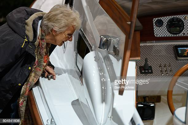 Guests look at the Charlotte made by Princess Yachts during the London Boat Show at ExCel on January 11 2016 in London England The London Boat Show...