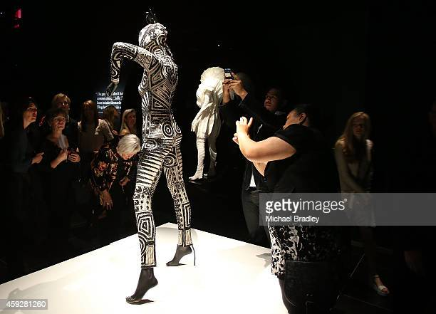 Guests look at the exhibits on show at the Auckland War Memorial Museum's World of Wearable Art exhibition opening at Auckland Museum on November 20...