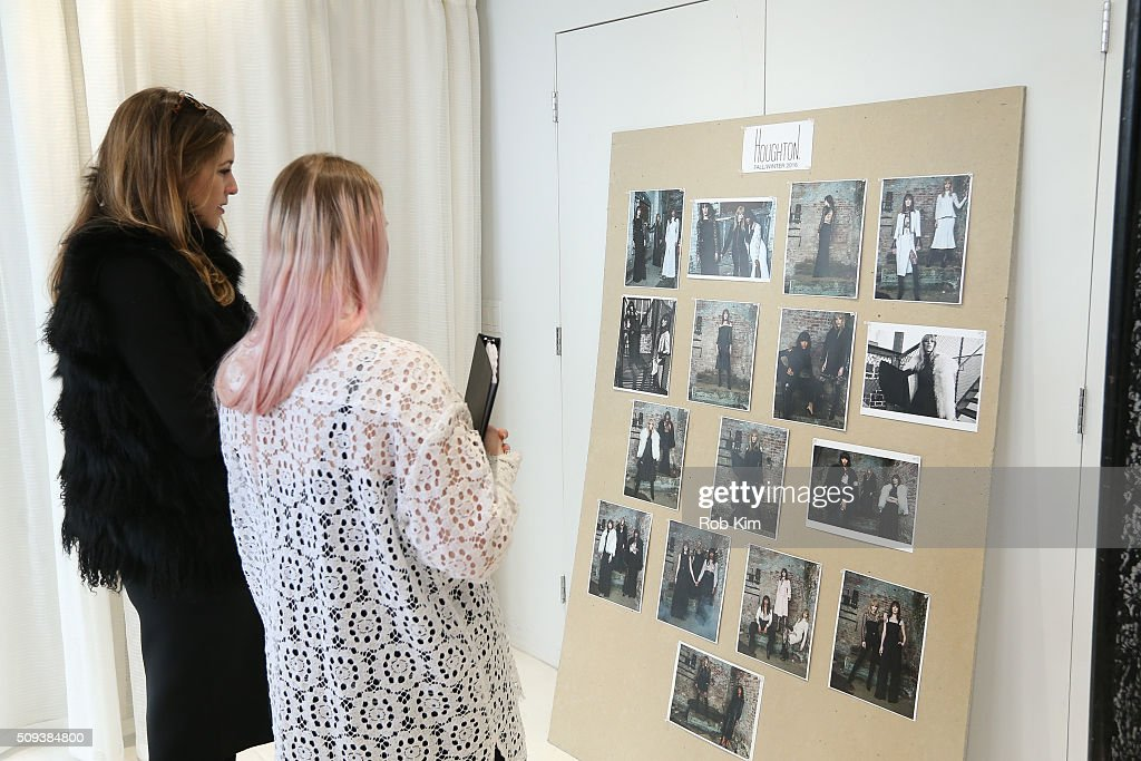 Guests look at the look board at Houghton presentation during Fall 2016 New York Fashion Week at Houghton Atelier on February 10, 2016 in New York City.