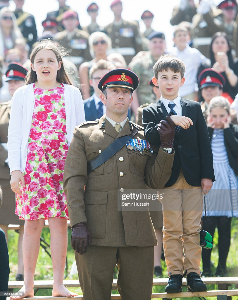Guests look on at the Royal Review of The Royal Artillery on the occasion of their Tercentenary at Knighton Down on May 26, 2016 in Lark Hill, England.