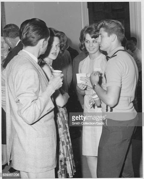 Guests mingle and enjoy refreshments at an Archives Association Party for new employees College Park Maryland 1963