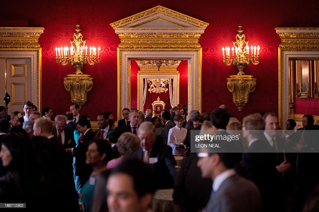 Guests mingle during a reception in Clarence House, central London on October 24, 2013. The reception was for members of British Indian and Sri Lankan communities, ahead of the Duke and Duchess' tour of India and Sri Lanka in November.