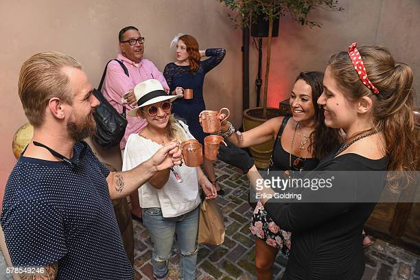 Guests mingle in the courtyard upon arriving at SMIRNOFF vodkas celebration of the 75th Anniversary of the original Moscow Mule during Tales of the...