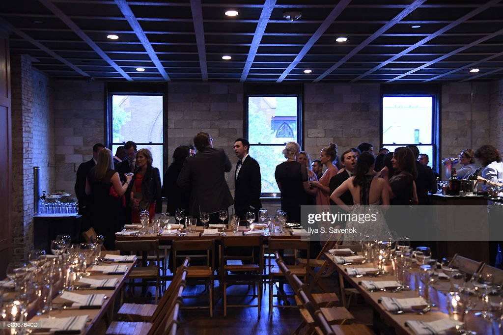 Guests mingle near the table setup during the Turnt Limit Hosted By Fusion And Tumblr During WHCD Weekend at Ghibellina on April 30, 2016 in Washington, DC.