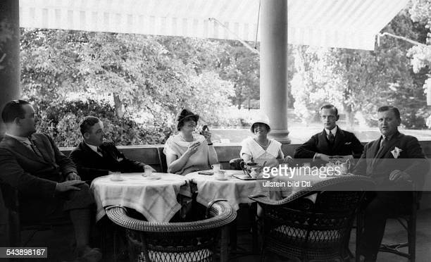 Guests of the motor race on the veranda of the hotel 'Stephanie' in BadenBaden Photographer Atelier Binder Published by 'Die Dame' 23/1924Vintage...