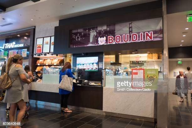 Guests order food at Boudin a San Francisco chain restaurant serving sourdough bread at the Westfield Valley Fair shopping mall in the Silicon Valley...
