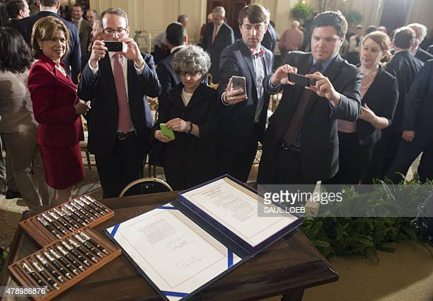 Guests photograph HR 2146 Defending Public Safety Employees' Retirement Act which includes fast track trade promotion authority that allows US...