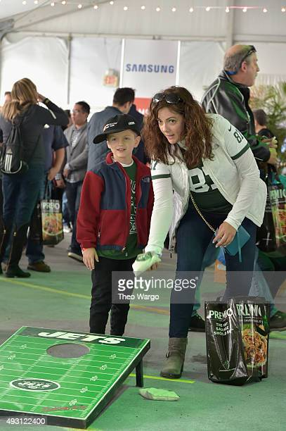 Guests play cornhole toss by the Samsung kitchen during Jets Chefs The Ultimate Tailgate hosted by Joe Namath and Mario Batali Food Network Cooking...