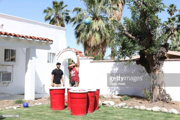 Guests play giant beer pong at 40z and Waffles x Coachella Party on April 15 2017 in Palm Springs California