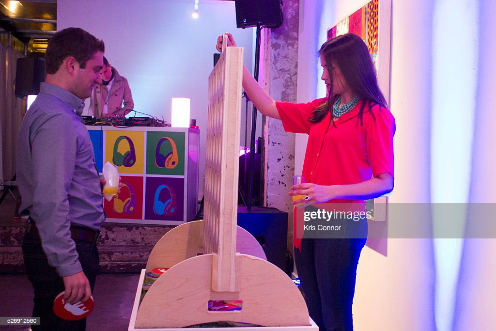 Guests play political connect four during the 2016 CNN Correspondents' Brunch at the Longview gallery in Washington, DC on May 1, 2016.