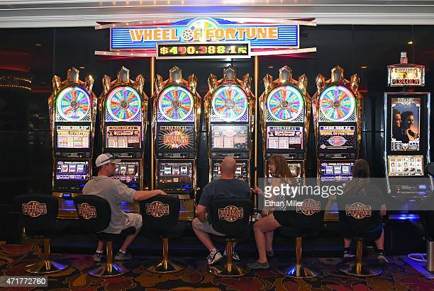 Guests play slot machines at the Riviera Hotel Casino on April 30 2015 in Las Vegas Nevada The Las Vegas Convention and Visitors Authority purchased...