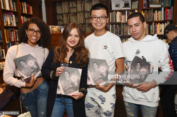 Guests pose as Brooklyn Beckham signs WHAT I SEE at Rizzoli New York at Rizzoli Bookstore on September 10 2017 in New York City