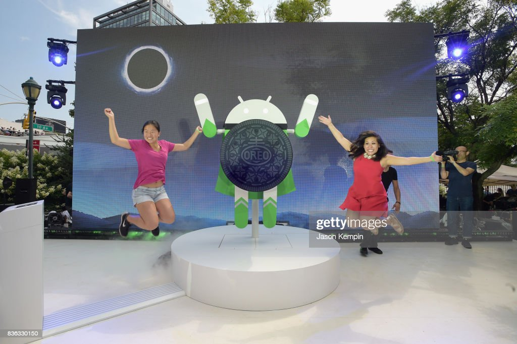 Guests pose for a photo as Google and Oreo reveal Android OREO during the solar eclipse at the 14th street park on August 21, 2017 in New York City.