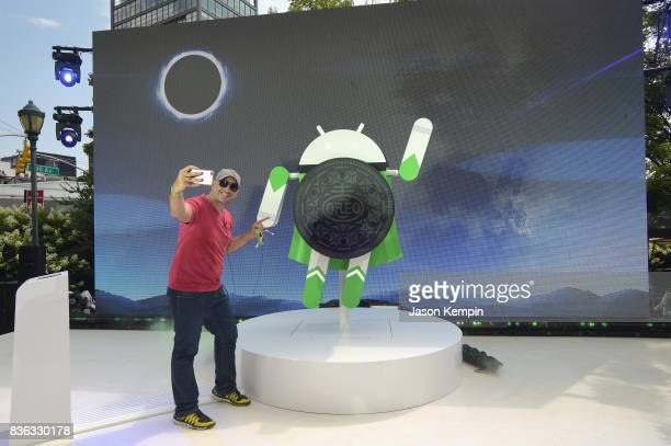 Guests pose for a photo as Google and Oreo reveal Android OREO during the solar eclipse at the 14th street park on August 21 2017 in New York City