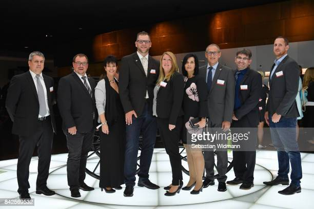 Guests pose for a picture during the Awarding Ceremony at the 20th anniversary of Volunteering for the Club 100 at MercedesBenz Museum on September 4...