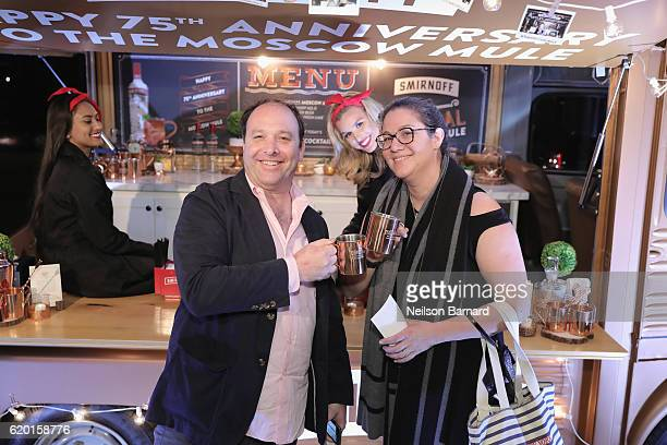 Guests pose in front of the Smirnoff Copper Truck with their complimentary Smirnoff Moscow Mule Mugs during the 2016 New York Taste presented by Citi...