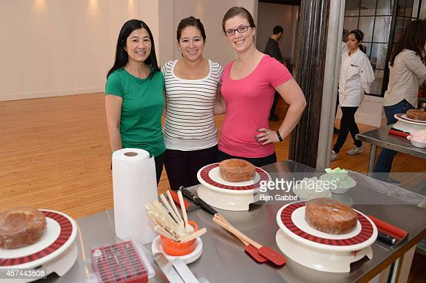 Guests pose with Anolon Gourmet Cookware at Anolon Cookware presents The Art Of Cake Decorating with Billy's Bakery NYC as a part of the Artisanal...