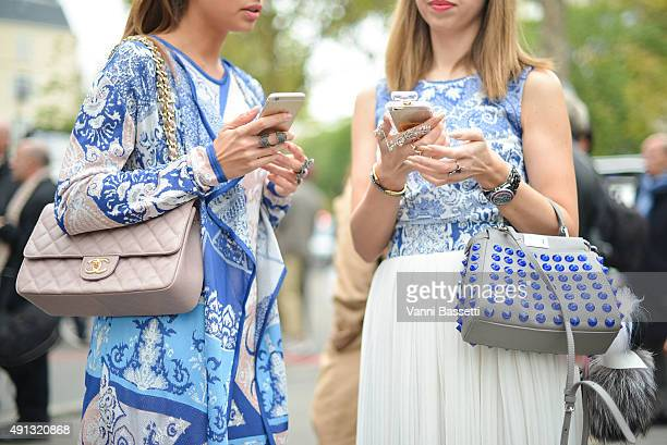 Guests pose with Chanel and Fendi bags before the John Galliano show at the Palais de Tokyo during Paris Fashion Week SS16 on October 4 2015 in Paris...