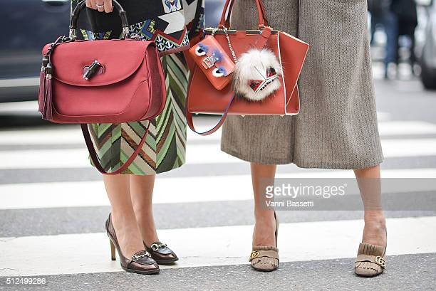 Guests pose with Gucci and Fendi bags and Gucci shoes before the Etro show during the Milan Fashion Week Fall/Winter 2016/17 on February 26 2016 in...