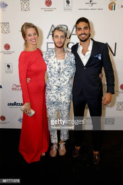 Guests pose with Jacob Abrian at the Arab Fashion Week Ready Couture Resort 2018 Gala Dinner on May 202017 at Armani Hotel in Dubai United Arab...