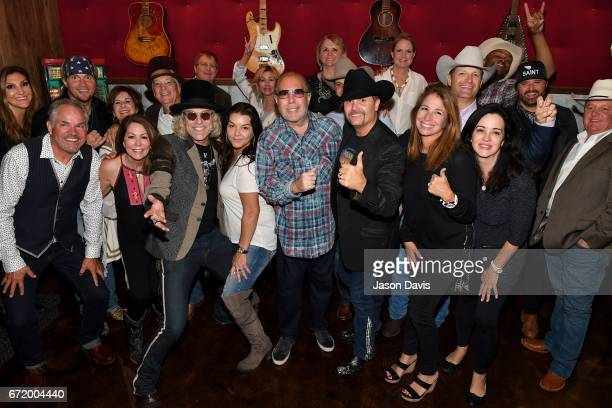 VIP guests pose with Recording Artists Big Kenny and John Rich of Big Rich Gretchen Wilson Randy Houser and Cowboy Troy during a private concert for...