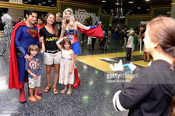 Guests pose with Superman and Superwoman during Wizard World Comic Con Chicago 2016 Day 4 at Donald E Stephens Convention Center on August 21 2016 in...
